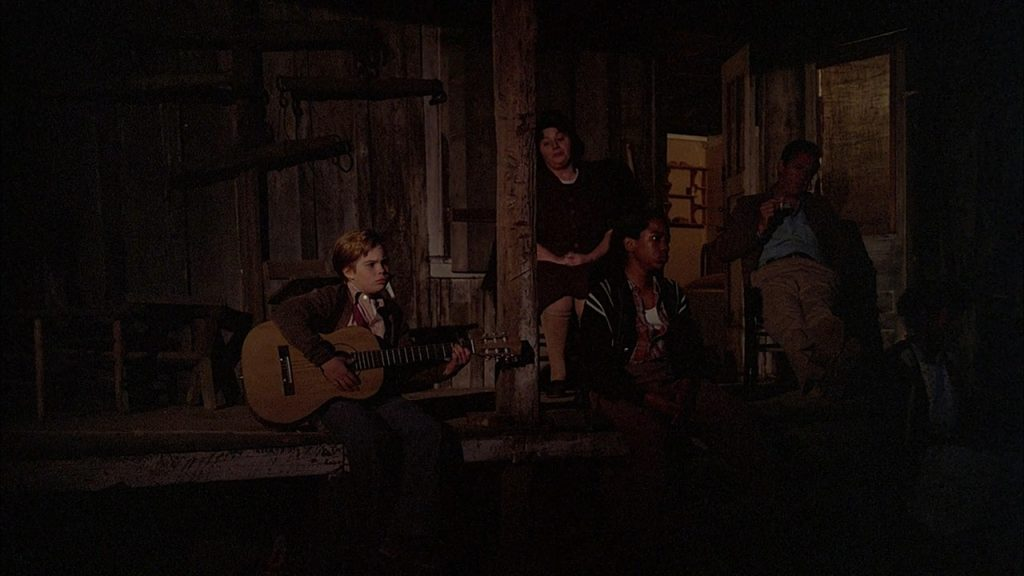 Young Elvis and his family singing in the black of night