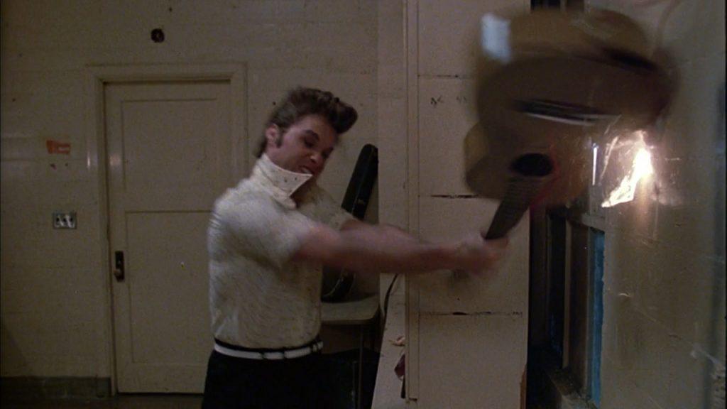 Kurt Russell trashing the guitar