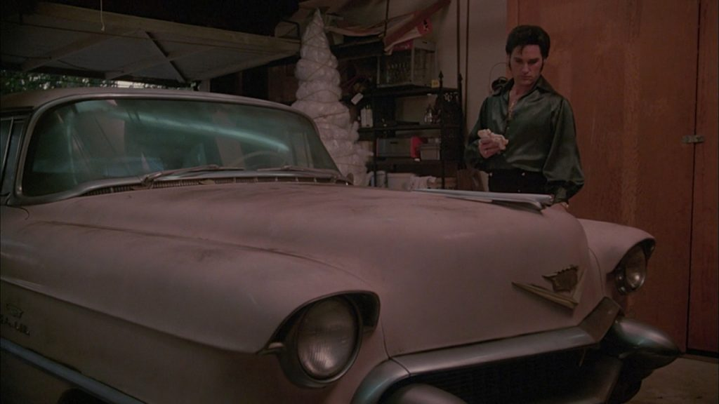 Elvis and the famous pink Cadillac
