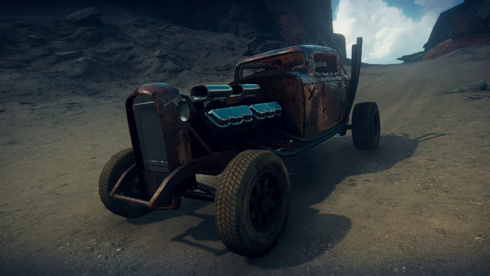 Elvis the GMC V12 hot-rod in Mad Max videogame, rusty version, front quarter