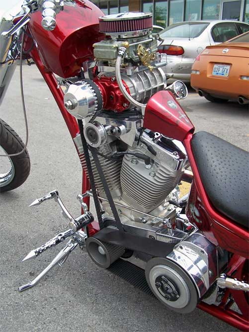 Unusually supercharged V-twin chopper, engine close-up, left side.